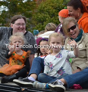 Riders on the Bonita's Early Childhood Learning Center float wave to the crowd during the Giant Pumpkin Parade on Saturday, Oct. 8. (Maia Zewert photo)