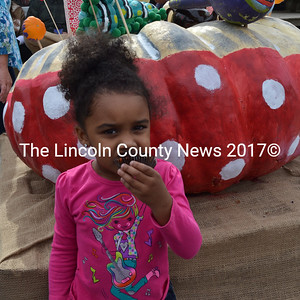 Amoraa Almodovar enjoys a cupcake before the Damariscotta Pumpkinfest parade on Saturday, Oct. 8. (Maia Zewert photo)