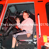 Damon Lincoln waves to his friends from behind the wheel of a Westport Island fire truck during the Wiscasset Fire Department's open house Oct. 12. (Charlotte Boynton photo)