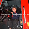 Christopher Lincoln sits in the cab of a Westport Island fire truck during the Wiscasset Fire Department's open house Oct. 12. (Charlotte Boynton photo)
