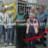 Waldoboro Food Pantry Co-director Lou Cook cuts the ribbon to open the pantry's new location at 251 Jefferson St. From left: Town Manager Linda-Jean Briggs, Tina Cunningham, Jane Lichtman, Cook, Mary Littell (back), Gloria Bowers, Wanda Collamore, and Assessors' Agent Darryl McKenney. (Alexander Violo photo)