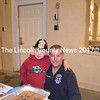 C.J. Marcoux and Wiscasset Deputy Fire Chief John Merry keep an eye on the goodie table during the department's open house Wednesday, Oct. 12. C.J. is the son of Chris and Bonny Marcoux. (Charlotte Boynton photo)