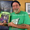 "Newcastle artist Glenn Chadbourne holds a copy of his new adult coloring book, ""Uncle Glenny's Zombie 'Pocalypse."" (J.W. Oliver photo)"