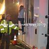 Damariscotta firefighter Chris Hilton helps a young girl exit the Damariscotta Fire Department's smoke trailer. (Charlotte Boynton photo)