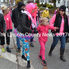 Breast cancer survivors and supporters of efforts to combat breast cancer walk through Damariscotta during the Making Strides Against Breast Cancer event Sunday, Oct. 23. (Maia Zewert photo)