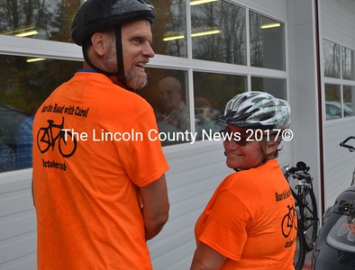 Tom Bartol and Barbara Moss arrive at the Windsor Volunteer Fire Department for Dr. Carol Eckert's memorial service Saturday, Oct. 22, after biking through the rain from Augusta. (Abigail Adams photo)