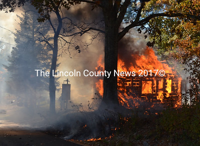 Fire engulfs a shed in North Newcastle on Wednesday, Oct. 19. The cause of the fire has not been determined, according to Newcastle Fire Chief Clayton Huntley. (Maia Zewert photo)