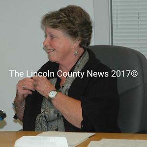 "Waldoboro Selectman Jann Minzy puts on a ""civility"" pin from Town Manager Linda-Jean Briggs. (Alexander Violo photo)"
