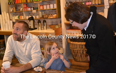 From left: David Spinney laughs as daughter Pearl Spinney shows U.S. Sen. Susan Collins her teeth at Treats in Wiscasset on Tuesday, Oct. 25. (Abigail Adams photo)
