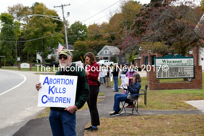 "John Pray, of Wiscasset, holds a sign that reads ""abortion kills children"" during a Life Chain event in Wiscasset on Sunday, Oct. 2. (J.W. Oliver photo)"