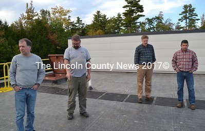 From left: Wiscasset Selectman Ben Rines, Wiscasset Community Center Programs and Facility Manager Robert McDonald, Selectman Jeff Slack, and Parks and Recreation Director Todd Souza examine the recently replaced roof of the Wiscasset Community Center on Monday, Sept. 20. (Abigail Adams photo)