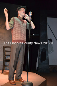 "Lincoln Academy student Jonah Daiute plays a radio announcer in a dress rehearsal of ""These Shining Lives"" at the Parker B. Poe Theater in Newcastle. (Christine LaPado-Breglia photo)"