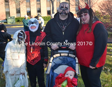"Halloween strikes all age groups at Wiscasset's ""Nightmare on Federal Street."" From left: Elijah and Camron Davis, John Matheney with baby Wyatt Matheney, and Sandy Kennedy. (Abigail Adams photo)"