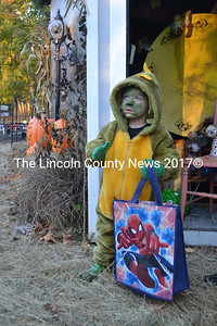 Zayden Vogt, of Wiscasset, watches one of the actors at the Haunted Castle's Keep in New Harbor on Monday, Oct. 31. (Maia Zewert photo)