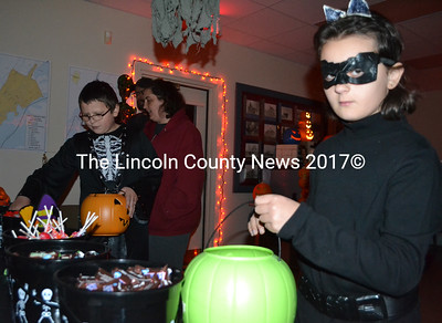 Aidan and Marissa McGraw collect candy at the Newcastle Fire Department. (Maia Zewert photo)