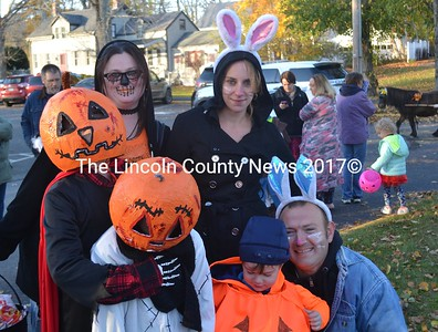 From left: children Blaze and Erik Dube and Theodore Fessenden sport homemade pumpkin costumes at Wiscasset's annual Halloween parade. They were joined, from left, by Rachel Henson, Anna Sarver, and Randee Jarrett. (Abigail Adams photo)