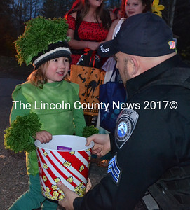 Adley Cawthon, of Alna, tells Sgt. Jason Warlick about her costume during the Damariscotta Police Department's annual trunk-or-treat event. (Maia Zewert photo)