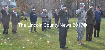 Veterans salute during a flag-raising at Schooner Cove in Damariscotta the morning of Veterans Day, Friday, Nov. 11. (Maia Zewert photo)