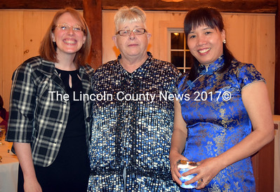 From left: Mobius Inc. Executive Director Becca Emmons and board of directors President Shirley-Ann Davison present the Dedicated Community Member Award to Direct Support Professional Ying Zhang. (J.W. Oliver photo)