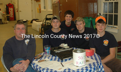From left: Jefferson firefighter Paul Huber sits with Jefferson Explorers Post members Nick Huber, Jonathan Burke, Alex Audette, and Joe Davis at Jefferson Fire and Rescue's 75th anniversary celebration. (Alexander Violo photo)