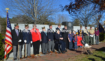 Members of the Bradford-Sortwell-Wright American Legion Post 54 and of the American Legion Auxiliary join Cub Scout Pack 603 for a Veterans Day service at the veterans monument in Wiscasset. (Charlotte Boynton photo)