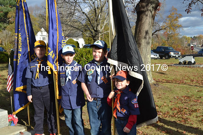 Cub Scouts from Pack 602 serve as the color guard during the Veterans Day service in Wiscasset. From left: Oscar Gallant, Garrett Marshall, Westley Bertan, and Daegin Marshall. (Charlotte Boynton photo)