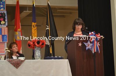 "Student Hannah Marsden (right) reads her poem ""Where Is the America I Love So"" during Medomak Middle School's Veterans Day celebration Thursday, Nov. 10. (Abigail Adams photo)"