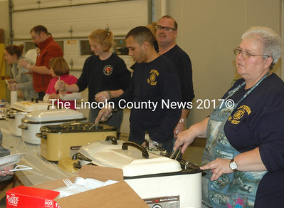 Volunteers serve dinner at the 75th anniversary open house and turkey supper at the Jefferson fire station Saturday, Nov. 12. (Alexander Violo photo)