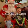 From left: Anderson, baby Margaret, and Bennett Hines pose for a photo with Santa Claus at the Kings Mills Union Hall in Whitefield on Sunday, Dec. 4. (Abigail Adams photo)