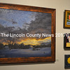 """Will Kefauver's oil painting """"Field at Dusk"""" (left) hangs next to three small paintings - (from top) Kefauver's """"Float & Buoy, Red,"""" DiTa Ondek's """"Spotted Piglet,"""" and Kefauver's """"Lemon"""" - at """"The Little Holiday Show"""" at the Kefauver Studio & Gallery in Damariscotta. (Christine LaPado-Breglia photo)"""