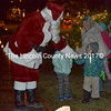 Everett Oakes greets Santa upon his arrival at Wiscasset's tree-lighting ceremony Saturday, Dec. 3. (Abigail Adams photo)