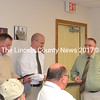 Lincoln County Sheriff Todd Brackett (right) recognizes outgoing Chief Deputy Ken Mason (left) and Sgt. Jason Nein for their service to the agency during a farewell party at the Lincoln County Communications Center in Wiscasset on Wednesday, Nov. 30. (Charlotte Boynton photo)