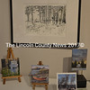 """A drypoint print by Deborak Kozik, """"Winter Woods,"""" graces the wall above four small paintings at """"The Little Holiday Show."""" (Christine LaPado-Breglia photo)"""
