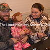 """Phil Main and Donna Bronn help daughter Emma Main make homemade ornaments at the crafts table during the Kings Mills Union Hall Association's annual """"old-fashioned"""" Christmas celebration Sunday, Dec. 4. (Abigail Adams photo)"""