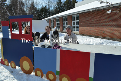 Wiscasset High School sophomores offer hot chocolate to the guests at the Winterfest activities Feb. 6. Shown left to right, Vanessa Dunn, Lorey Campbell, and Trinin Jeffery. (Charlotte Boynton Photo)