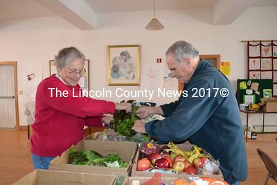 Help Yourself Shelf Co-chair Gretchen Burleigh-Johnson and volunteer Robert Bickford bag fresh vegetables for distribution to area families and to the Wiscasset Middle High School food pantry. (Charlotte Boynton photo)