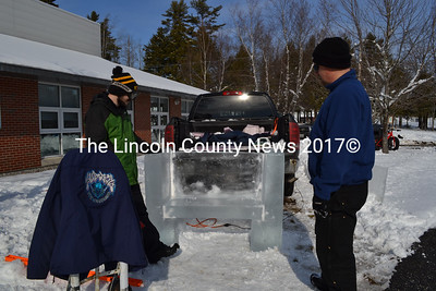 SubZero Ice Carvings representatives Jereme Augusta, left, and Jay Bluck carved a throne of ice at Wiscasset Winterfest activities, Feb. 6. (Charlotte Boynton photo)