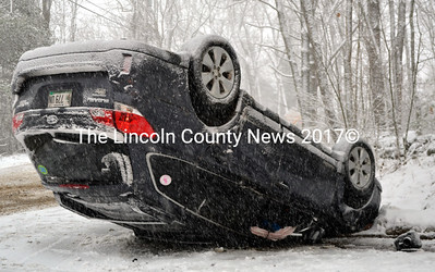 A Subaru Outback rests on its roof after a rollover on River Road in Newcastle on Friday morning, Feb. 5. The accident was one of several in Lincoln County during the snowfall Friday. (J.W. Oliver photo)