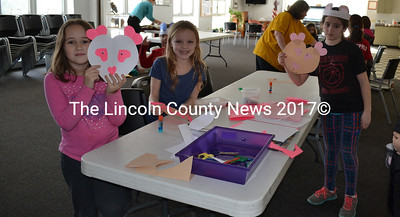 After being read a story about polar bears, these young artists make bear faces and bear ears at the Wiscasset Community Center during Winterfest activities, Feb. 6. (Charlotte Boynton Photo)