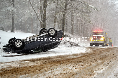 The Newcastle Fire Department responds to a rollover on River Road in Newcastle on Friday, Feb. 5. The driver was able to walk to an ambulance, according to Newcastle Fire Chief Clayton Huntley. (J.W. Oliver photo)