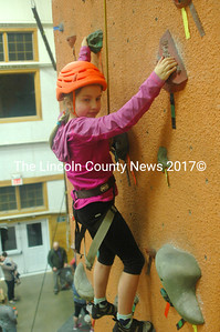 "Mina Hartmann reaches the top of the tallest climb. ""I really like to climb,"" she said, ""and this place is really awesome."" (Eleanor Cade Busby photo)"