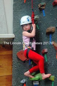 Eden Brehm, of Newcastle, made a valiant effort to climb and was a little discouraged at first. The 5-year-old was undaunted and tried several climbs, reaching higher with each attempt. (Eleanor Cade Busby photo)