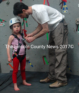Eden Brehm, 5, gets her safety gear double-checked before her climb. (Eleanor Cade Busby photo)