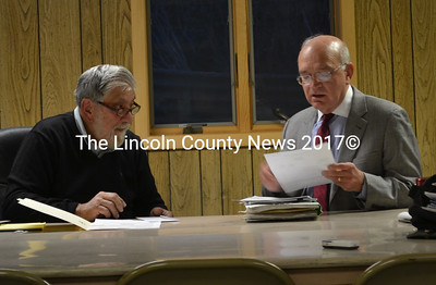 Edgecomb Board of Selectmen Chair Jack Sarmanian (left) and town attorney Bill Dale discuss a 2013 court order to remedy a land use violation on Monday, March 14. The selectmen said the property owner has not complied with the violation. (Abigail Adams photo)