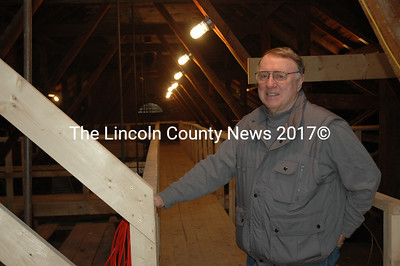 Wilt Jones, the co-chair of the Second Congregational Church's roof system restoration committee, stands in the church's newly renovated attic Wednesday, March 9. Construction on the interior of the church began in December 2015, and is part of a major roof renovation project. (Maia Zewert photo)