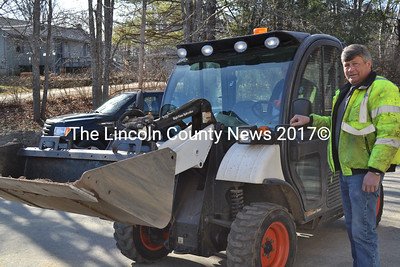 Wiscasset's new town mechanic, Ted Snowdon, helps a co-worker load the town's Toolcat onto a flatbed Tuesday morning, March 1. Snowdon was hired Feb. 14 to replace Mark Jones, who retired earlier this year. (Charlotte Boynton photo)