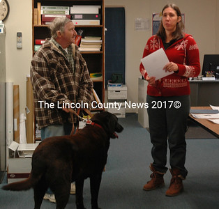 Somerville Town Clerk Kelly Payson-Roopchand presents the Dog of the Year Award to Riley, with owner Merle French, at the town office on April 6. (Alexander Violo photo)
