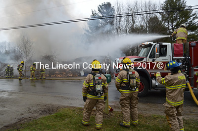 Firefighters from Damariscotta and Bristol work to extinguish a house fire on Lessner Road in Damariscotta on Thursday, April 7. (Maia Zewert photo)