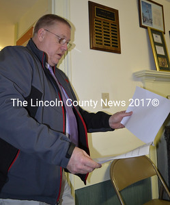 Lincoln County Sheriff Todd Brackett reviews a draft fireworks ordinance during the Alna Board of Selectmen's meeting on April 6. (Abigail Adams photo)