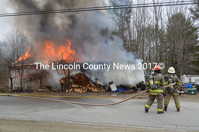 Area firefighters respond to a house fire on Lessner Road in Damariscotta on Thursday, April 7. A malfunction of a monitor heater in the home is believed to have started the fire, Damariscotta Fire Chief John Roberts said. (Maia Zewert photo)